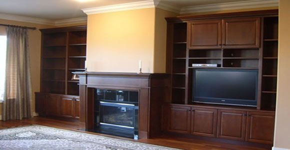 Dark wood mantel with built-in entertainment center